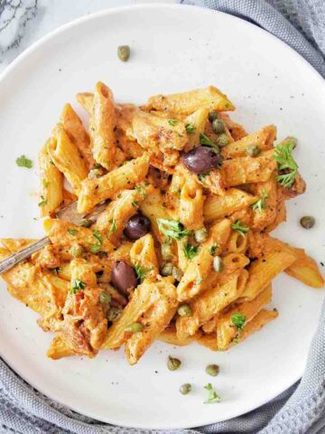 Instant Pot Penne Pasta on white plate with grey napkin