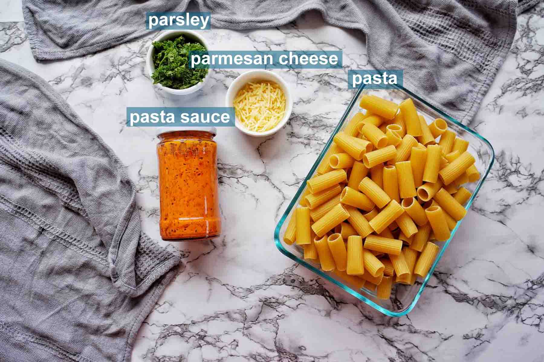 Ingredients for Instant Pot Rigatoni with jar sauce and text labels