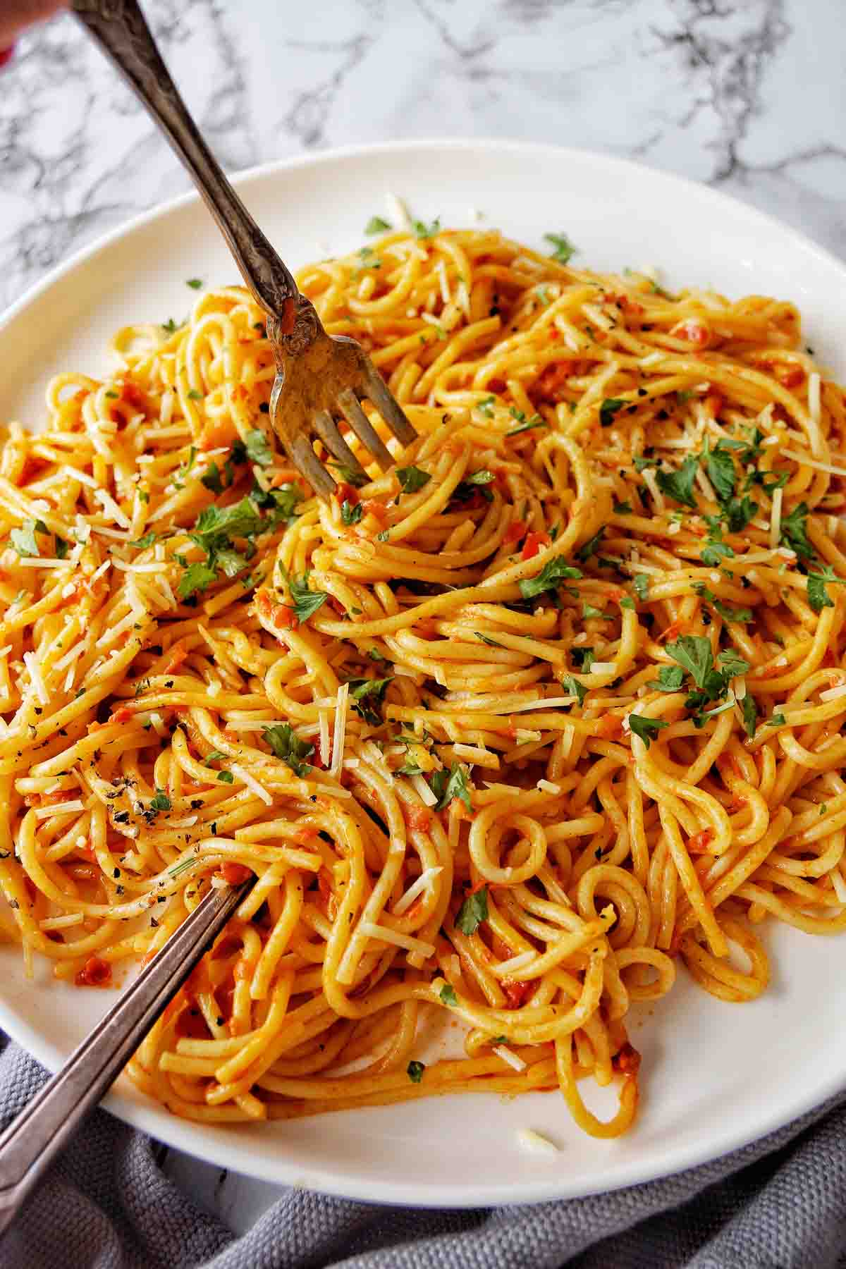 Instant Pot Spaghetti with Jar Sauce on a white plate with fork
