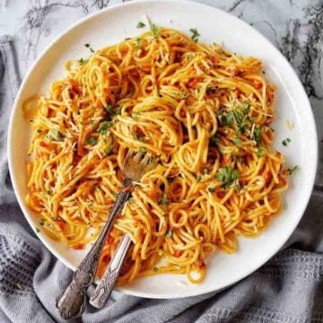 Instant Pot Simple Spaghetti on a white plate with fork and spoon