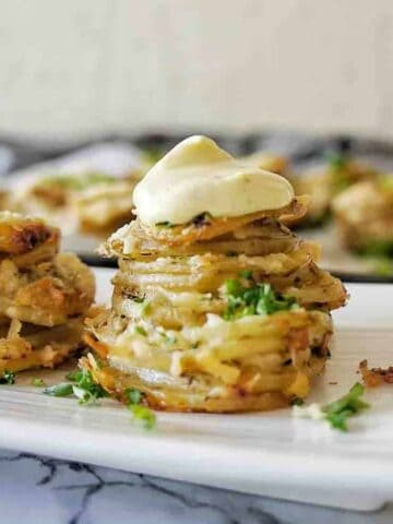Muffin Tin potato stack with sauce on top