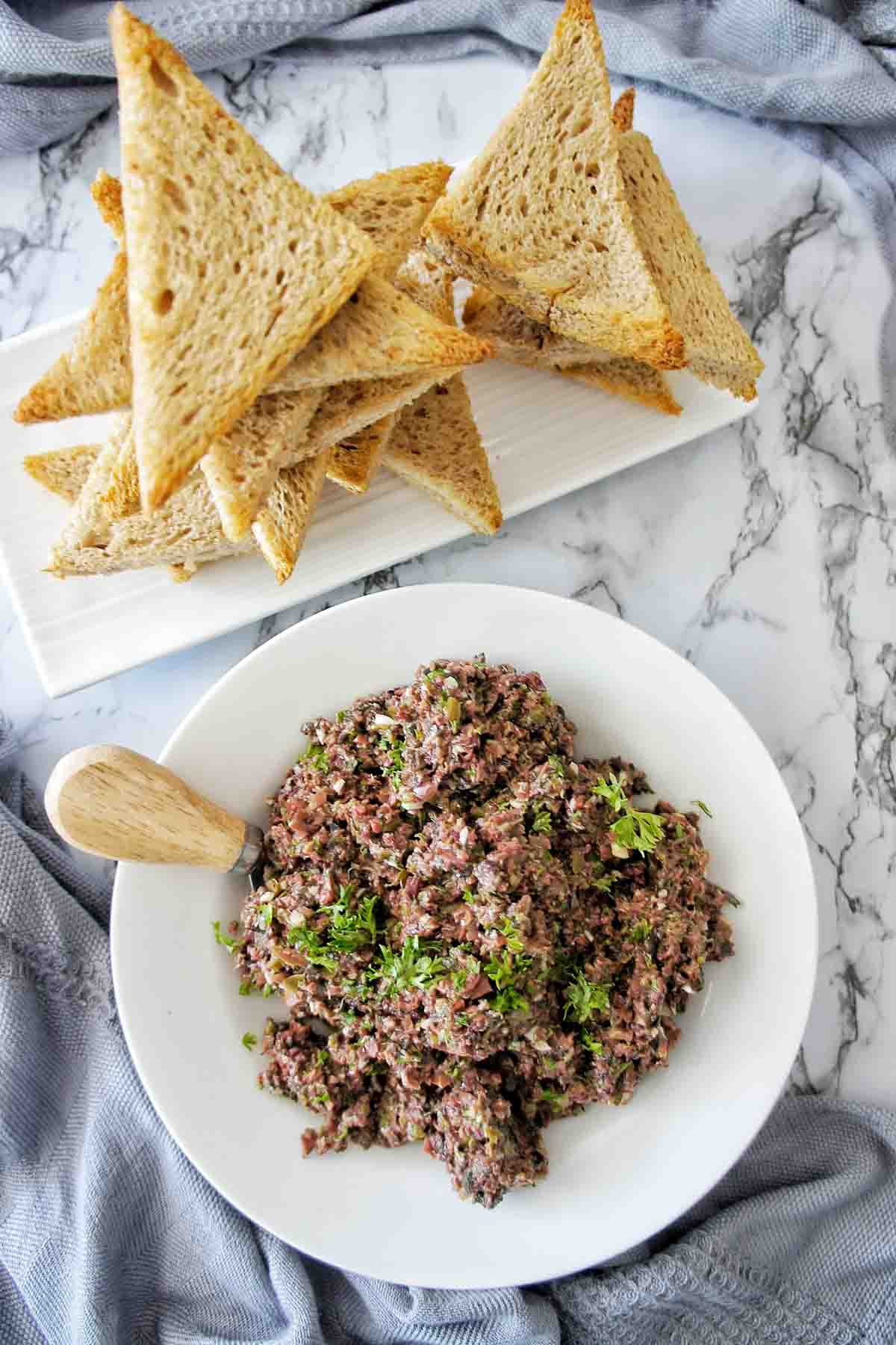 Olive tapenade in a white bowl