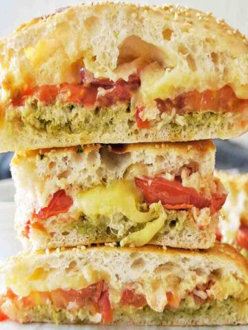Pesto Grilled Cheese stack with cheese oozing out