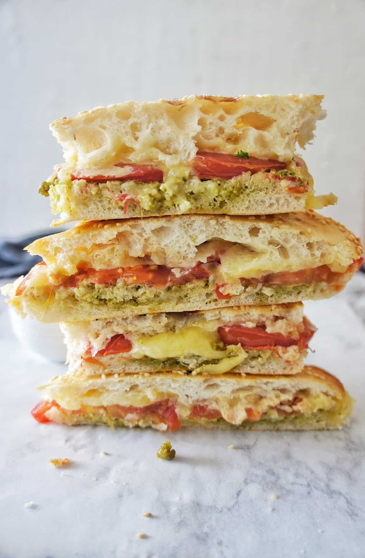 Pesto Grilled Cheese Sandwich halves stacked high with white background