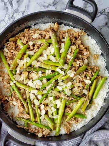 Pork with Asparagus and rice in sauté pan
