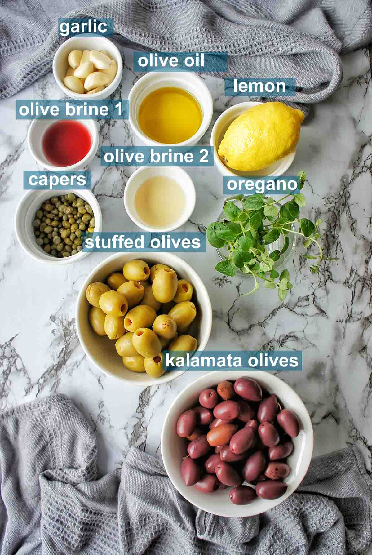 Roasted Olive Ingredients on marble background with text over lay