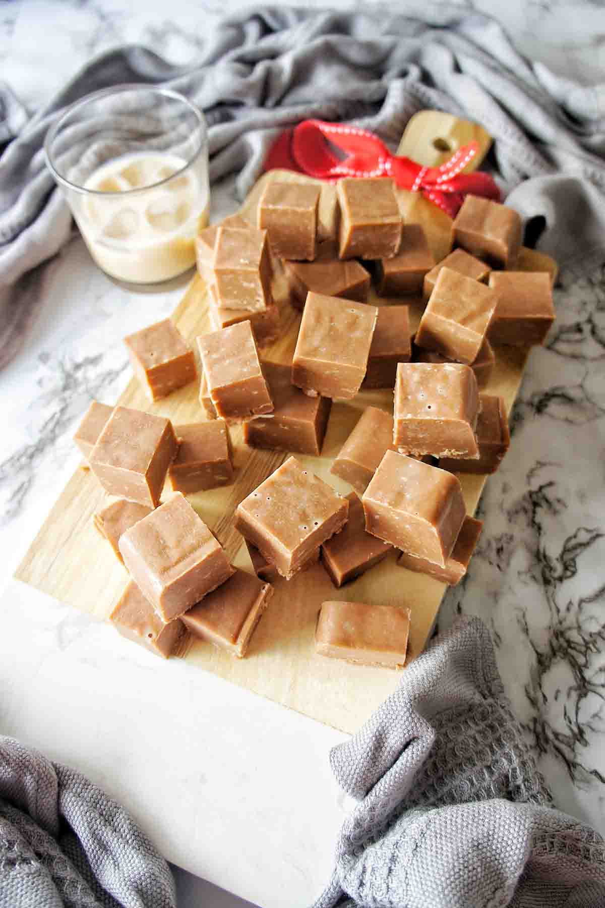Baileys Fudge pieces on a chopping board