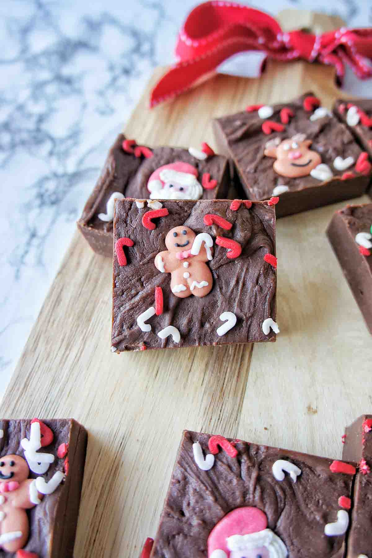 Slow Cooker Christmas Fudge with gingerbread man sprinlke