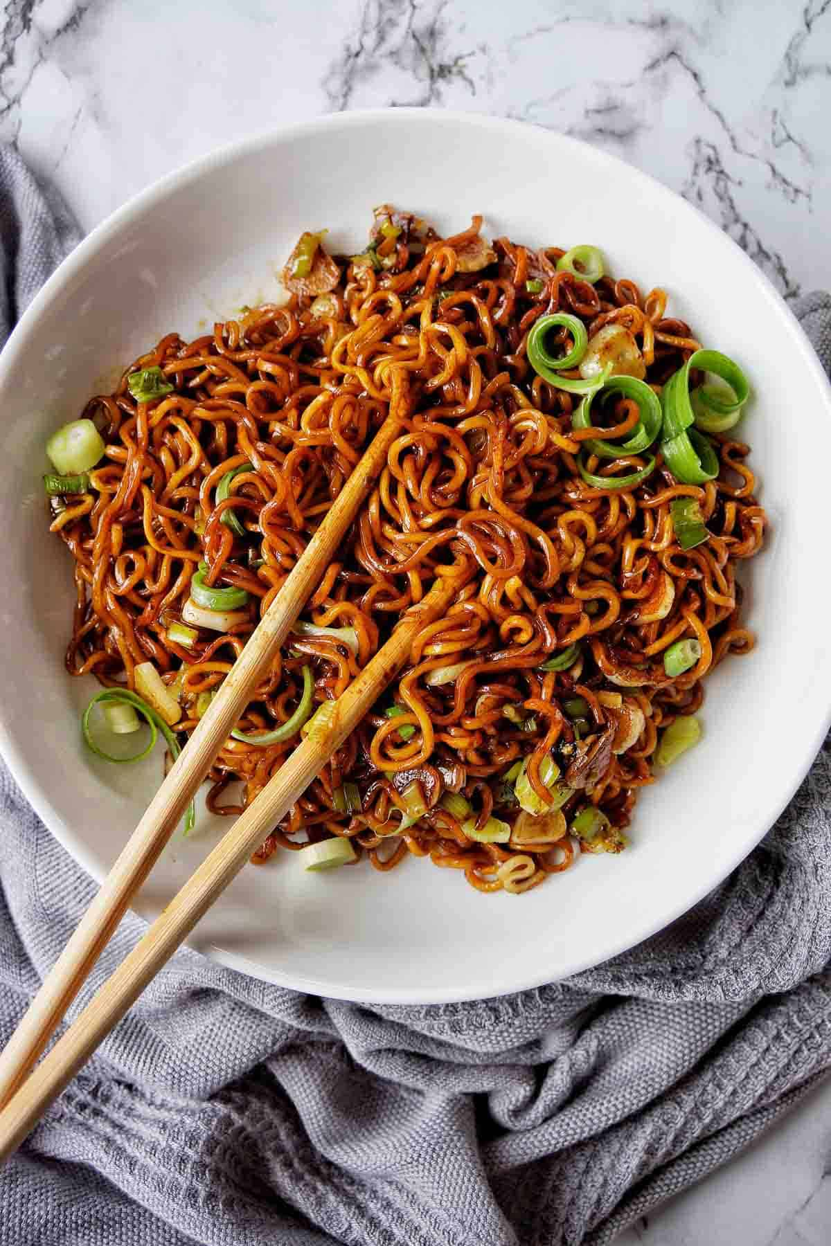 Soy Sauce Noodles in a white bowl with chopsticks