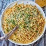 White Wine Pasta Sauce stirred through spaghetti on white plate